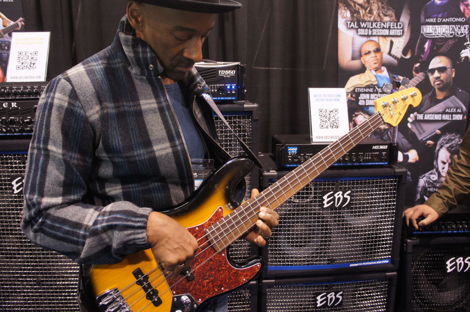 Marcus Miller checking out EBS gear and a Sandberg bass.